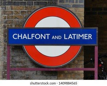 Little Chalfont, Buckinghamshire, England, UK - May 28th 2019: Chalfont and Latimer station London Underground Metropolitan railway roundel sign