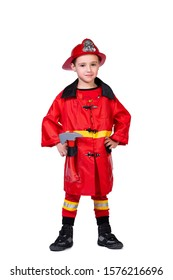 little cheerful boy in a fireman's robe: a red helmet with a coat of arms, coat, pants with stripes and an ax on a white isolated background. CONCEPT children dressing up for parties and New Year