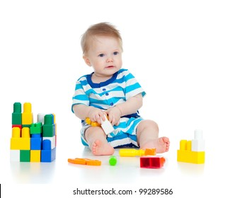 little cheerful child with construction set over white background