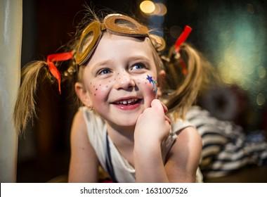 A little cheerful girl in a circus dreams