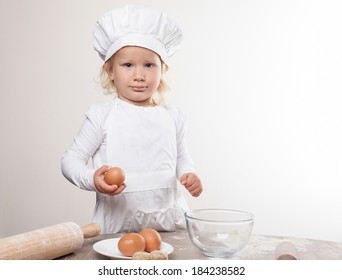 little chef  holding an egg
