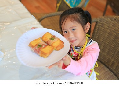 Little Chef showing French toast bacon.