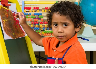 Little Child In Art Class Learning to Paint