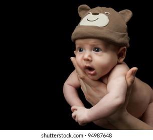 little child baby on black background