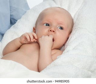little child baby  on white towel