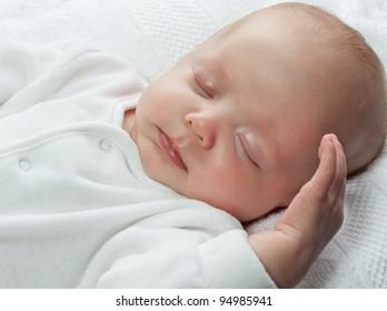 little child baby slipping on white