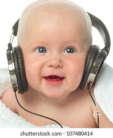 little child baby smiling closeup portrait isolated on white studio shot face positive happy listening music headphones