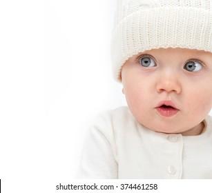 little child baby smiling  warm clothing hat isolated on white studio shot