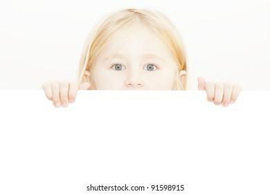 little child behind white board