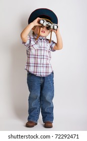 Little child boy looking binoculars lens isolated
