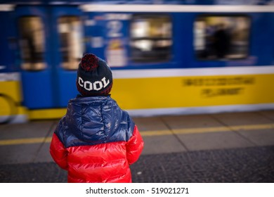Little child boy waiting for the train at the train station