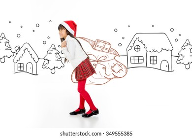 little child bringing a big christmas sack and walking in a snowy scene