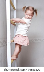 little child with bunches playing sports and climbing the stairs. Healthy lifestyle from childhood