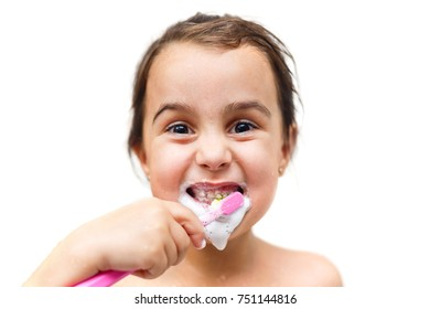 Little child with dental toothbrush brushing teeth.isolated on a white background