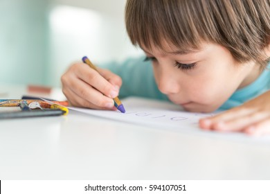 Little child drawing on the table