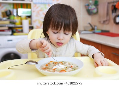 Little child eating scrambled eggs. Healthy nutrition