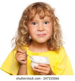 Little child eating yogurt