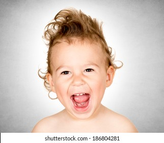 Little child with funny hairstyle screaming