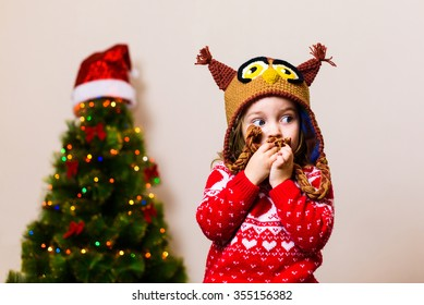 little child girl in front of a christmas tree making a wish