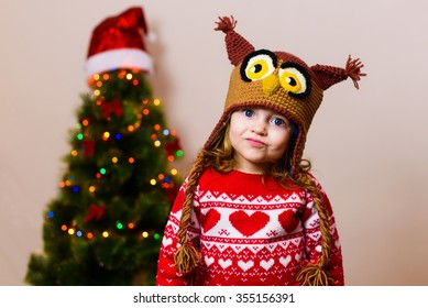little child girl in front of a christmas tree