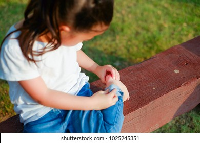 Little child girl naughty in playground until her've the foot wound
