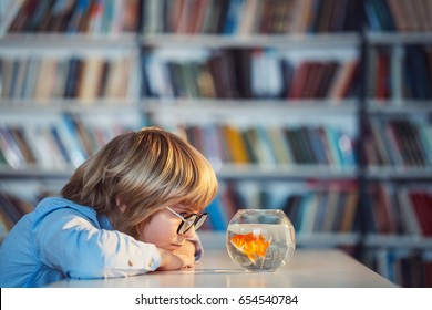 Little child with goldfish