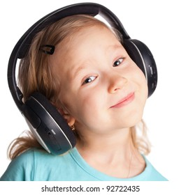 Little child in headphones isolated on white