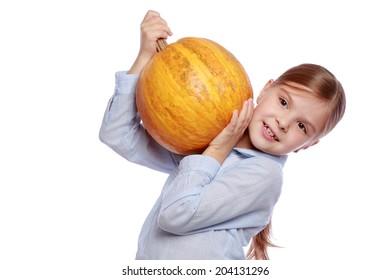Little child holding a pumpkin on halloween time