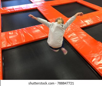 Little child jumping at trampoline in indoors playground, trampoline,trampoline jumping