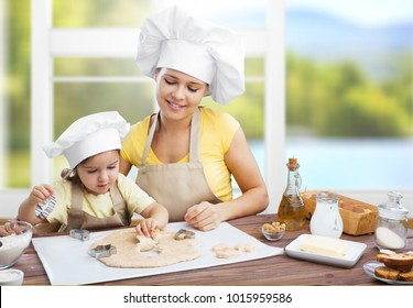 Little child and mother in kitchen