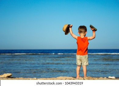 a Little child on the beach seashore