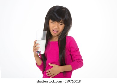 little child with painful expression after drinking milk