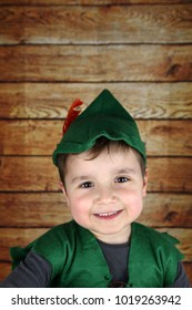 little child with a peter pan costume smiling