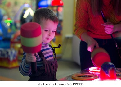 Little child play with arcade machine