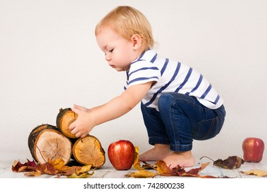 Little child playing with blocks of wood