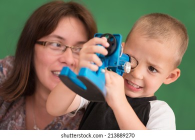 Little child playing with mother. Focus is on child.