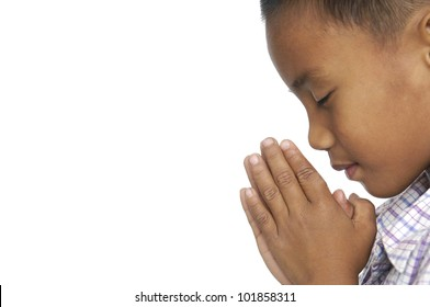Little Child praying over white background.
