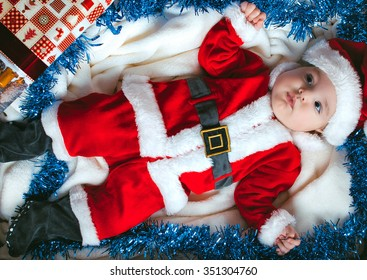 Little child in santa dress in the greeting box
