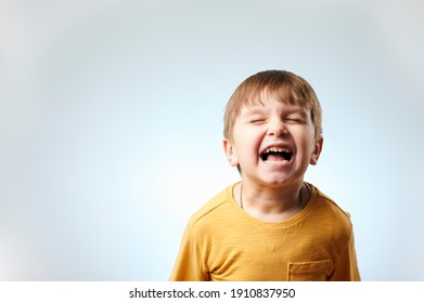 little child screaming with closed eyes on white background