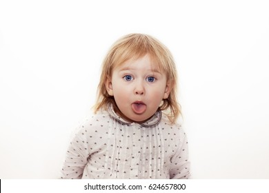 Little child shows tongue and teases