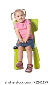 the little child sits on a chair