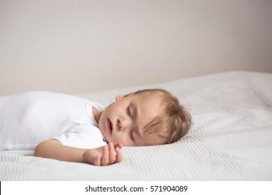 Little child sleep in baby room.