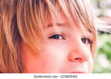 little child sly face expression outdoor - sensory connections