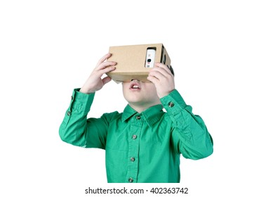 Little child uses virtual reality (VR cardboard) isolated on white background