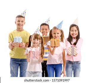 Little children with Birthday gifts on white background