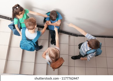 Little children bullying their classmate indoors