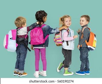 Little Children Carrying Backpack School