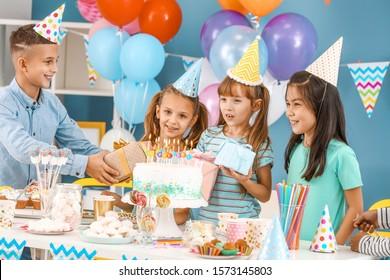 Little children celebrating Birthday at home