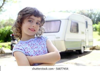little children girl posing caravan camping vacations summer
