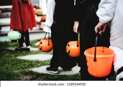 Little children in Halloween costumes